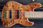 One of a kind custom shop K5- Swamp ash body-Poplar burl top.-Birdseye maple fretboard-Gold EVO frets- Optional electronics.