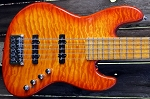 Discounted Blem-   Fred Hammond Signature Bass-Orange Burst  quilted  top - Bartolini B-Axis - Pike Audio Preamp  -Blem is a small metal flake in the finish in the back