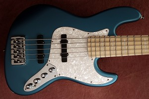 K534   Metallic ice blue   --Alder- your choice of pickups and preamp